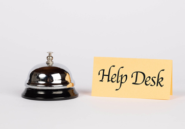 picture of bell and help desk sign