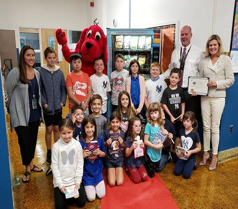 Students, administrators and special guests celebrate Leonardo Elementary School's new book-dispensing vending machine.