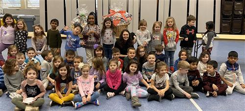 "Fairview students pose with ""welcome home"" baskets they made for Habitat for Humanity."