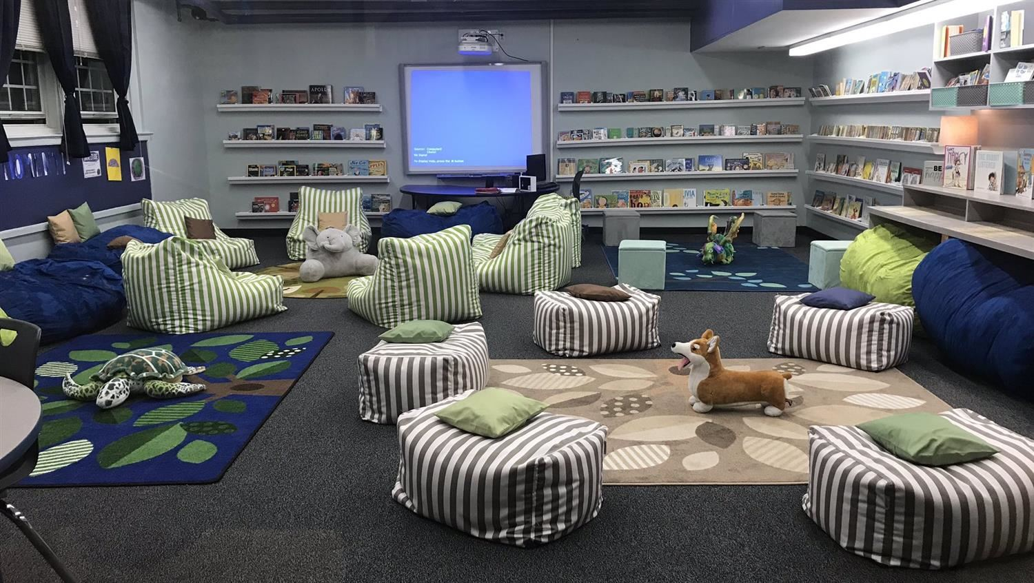 A look inside Port Monmouth's Koala Cove shows comfy chairs, stuffed animals, and shelves filled with books.